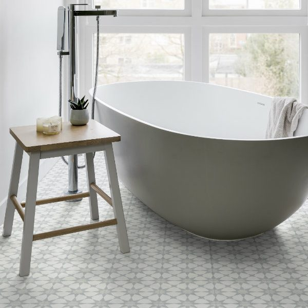 Ca' Pietra Atlas encaustic; Soft Grey. You'd need to be confident to have a bath in this room….  Edinburgh Tile Studio.