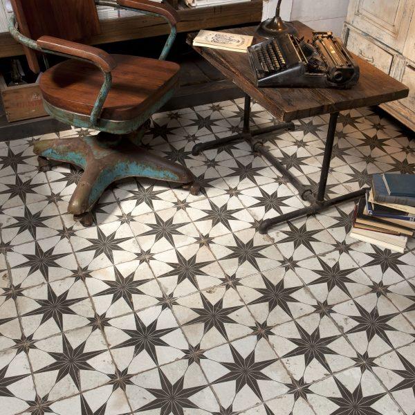 Ca' Pietra Spitalfields Ceramic, Retro Star.  That's an ergonomic chair, for sure. Edinburgh Tile Studio.